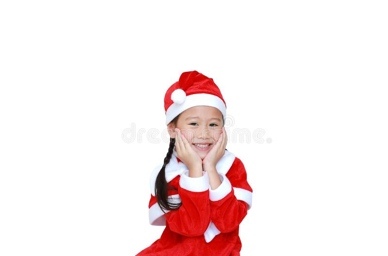 Happy child girl in Santa costume dress with copy space on white background. Merry Christmas and Happy New Year Concept.  stock photos
