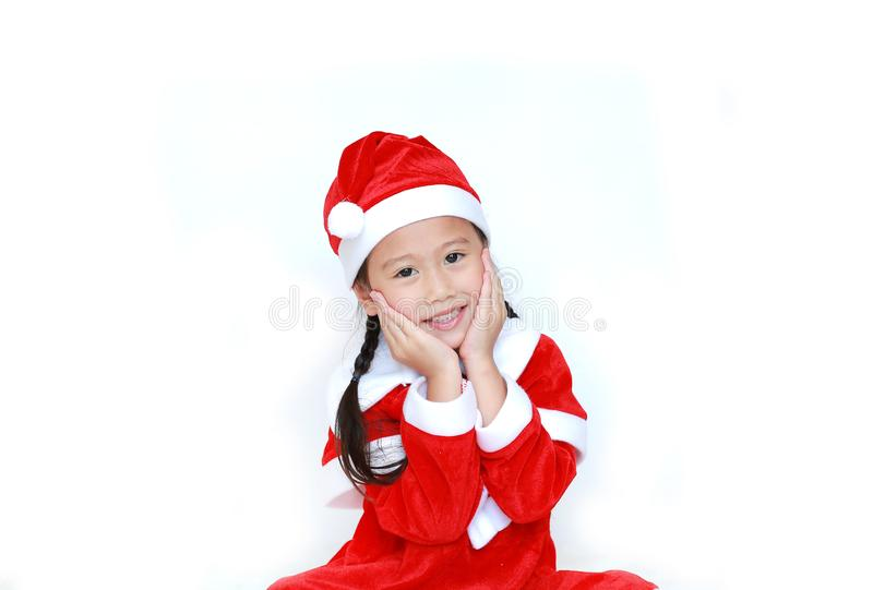 Happy child girl in Santa costume dress with copy space on white background. Merry Christmas and Happy New Year Concept.  royalty free stock photo