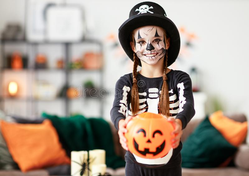 Happy   child girl in skeleton costume to halloween stock photography