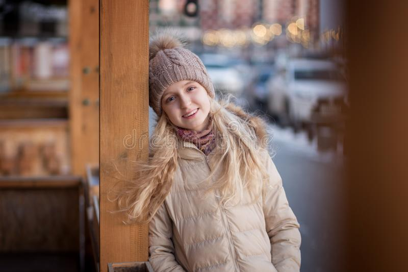 Happy child girl is in sunset winter. royalty free stock images