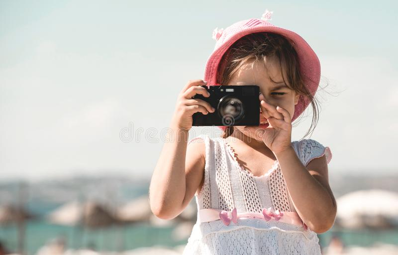 Happy Child Girl Tourist Taking Photos At Sea Side stock image