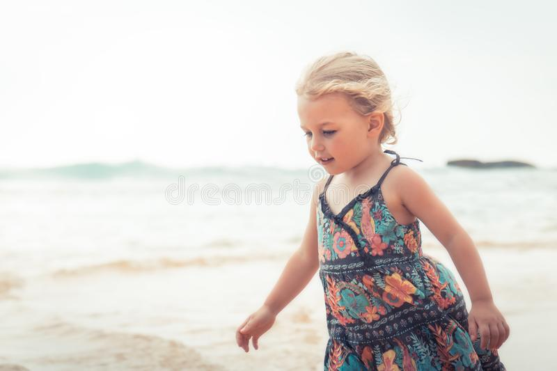 Happy child girl walking on beach tropical island during summer holidays concept carefree childhood travel lifestyle. Happy child girl walking on beach tropical royalty free stock photography