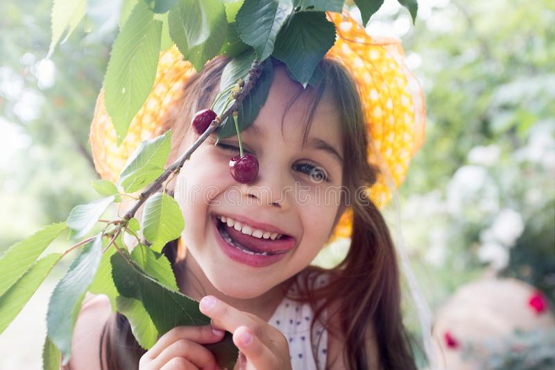 Happy Child Girl Welcomes Summer Season in the Cherry Tree royalty free stock photos