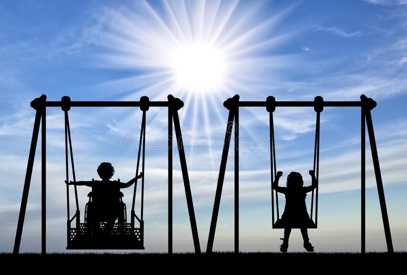 Happy child is handicapped in a wheelchair on an adaptive swing having fun with a healthy child together. Concept of the lifestyle of children with royalty free stock photos