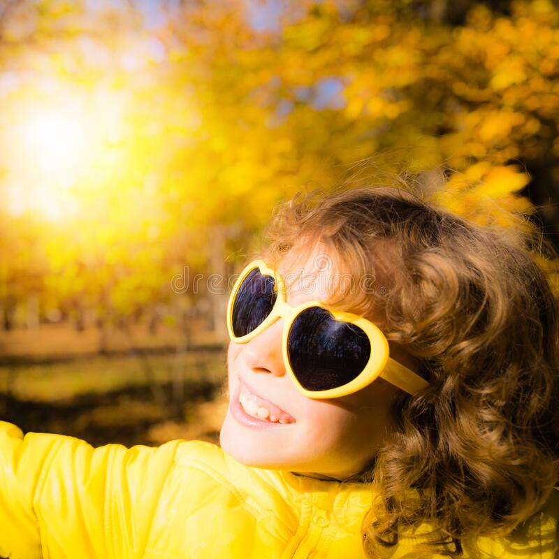 Happy child having fun outdoor in autumn park royalty free stock photos