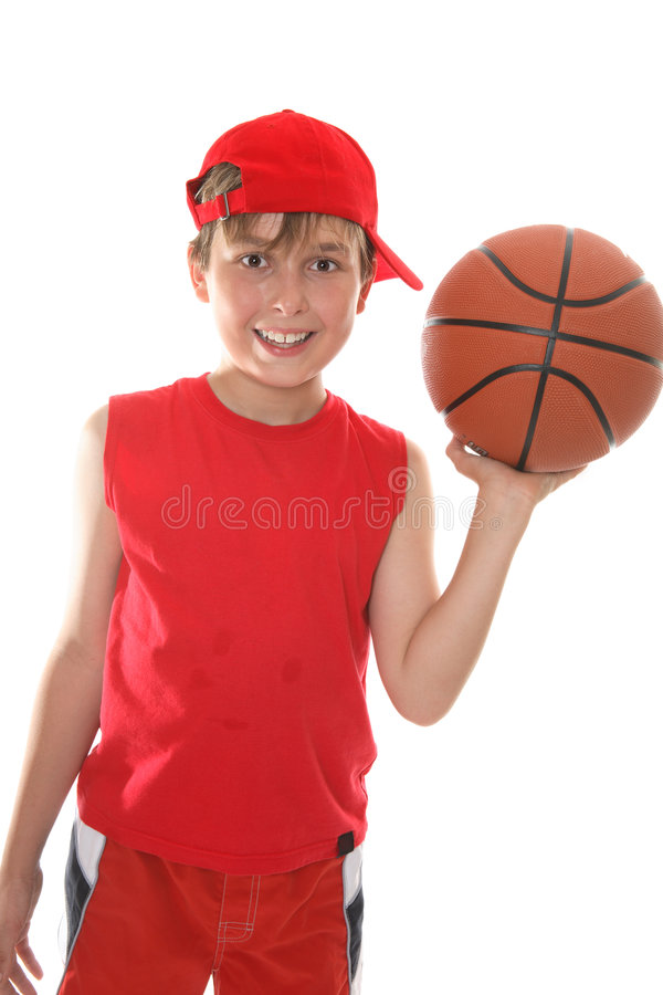 Happy child holding basketball royalty free stock photography
