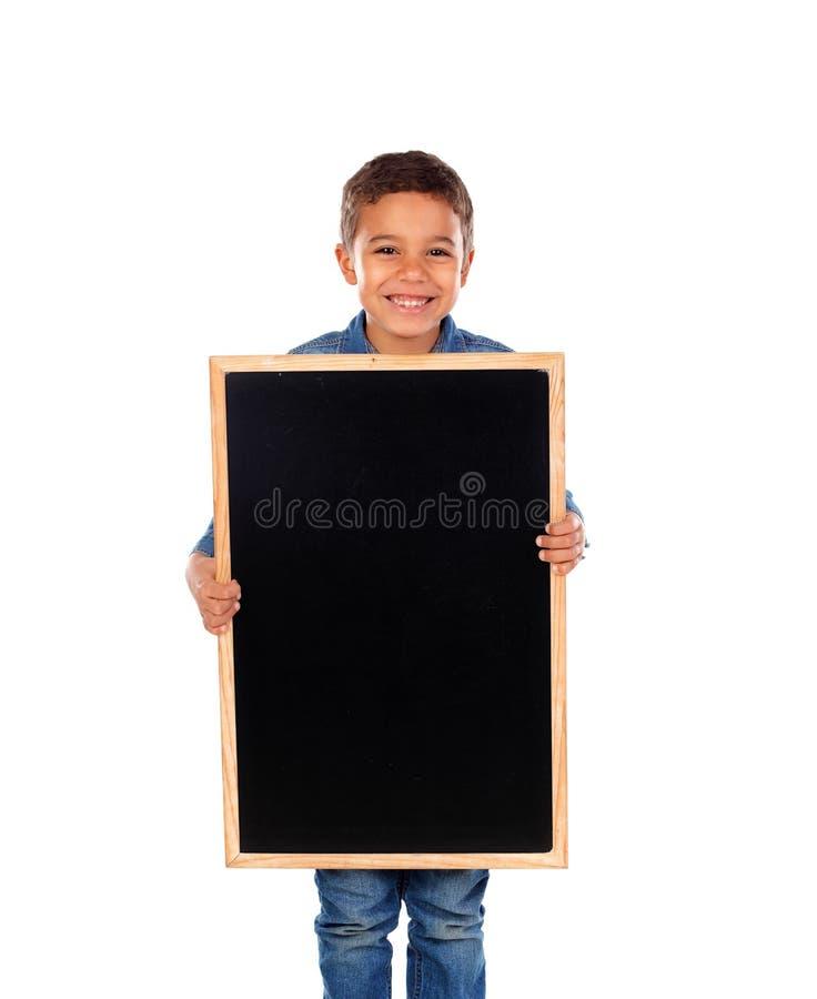 Happy child holding a blank slate stock photos