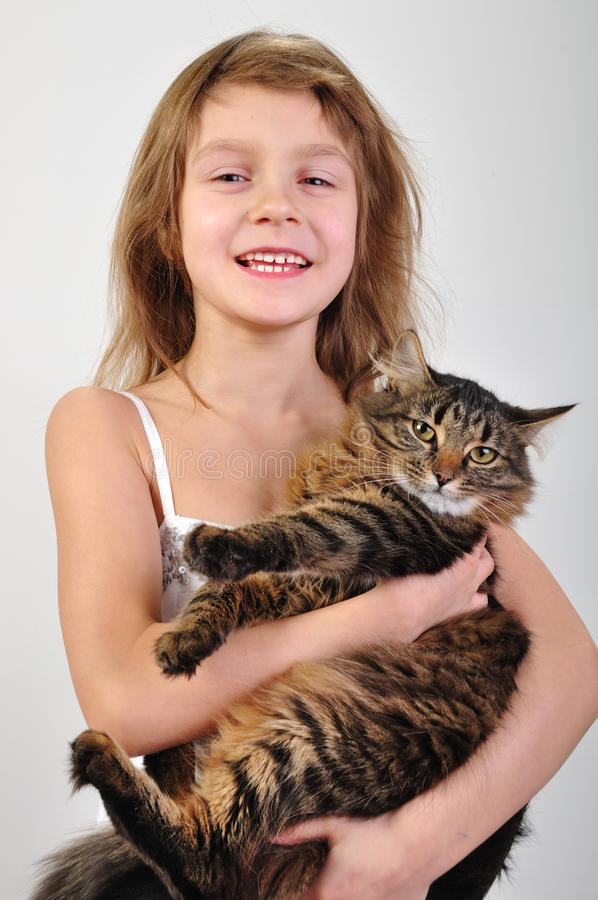 Download Happy Child Holding A Cat In Hands Stock Image - Image: 23400655
