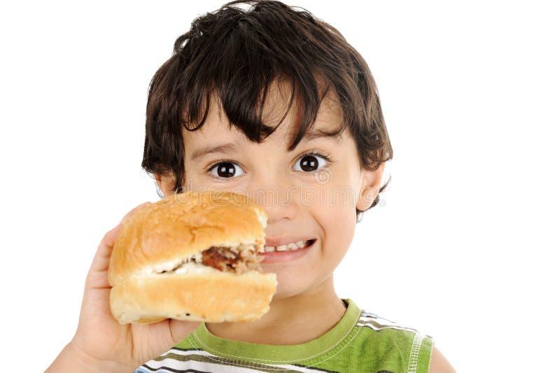 Happy child holding hamburger royalty free stock photography