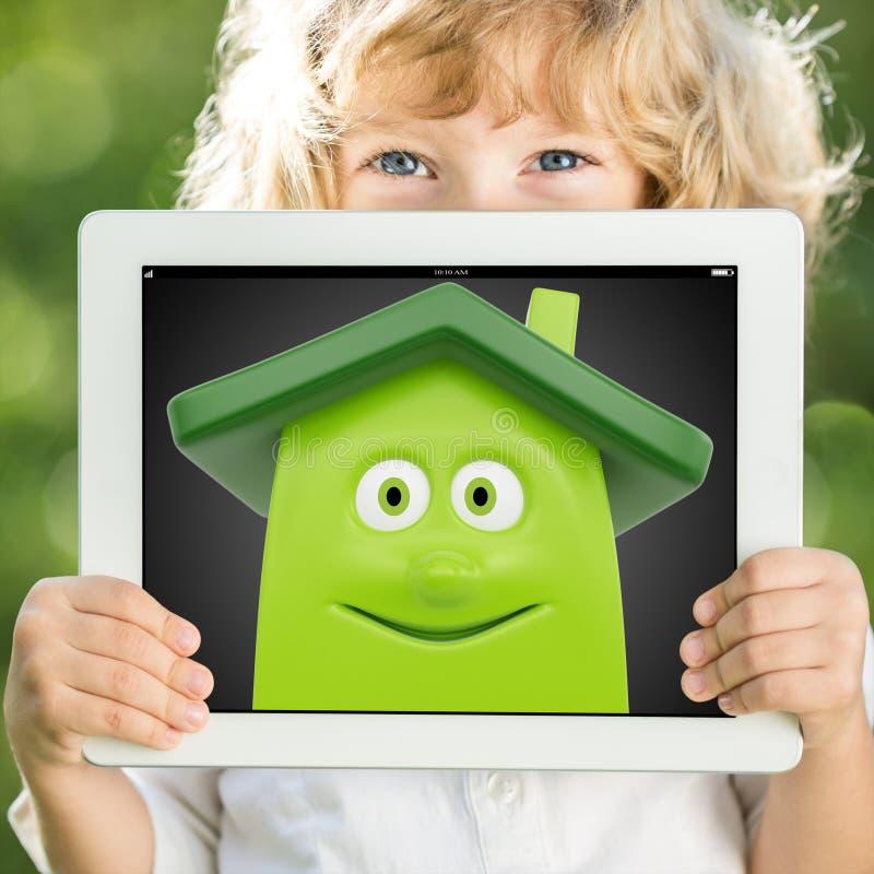 Child holding tablet PC stock illustration