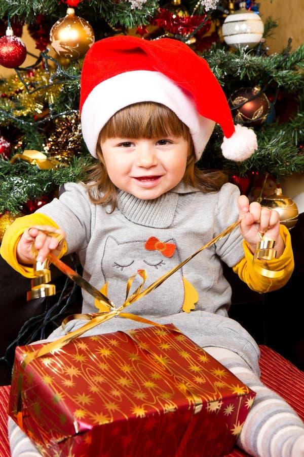 Free Happy Child In Santa Hat Opening Christmas Gift Box Stock Photo - 35861050