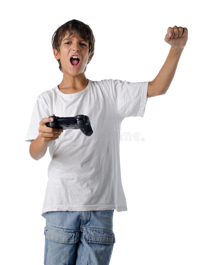 Happy child with joystick playing videogames stock image