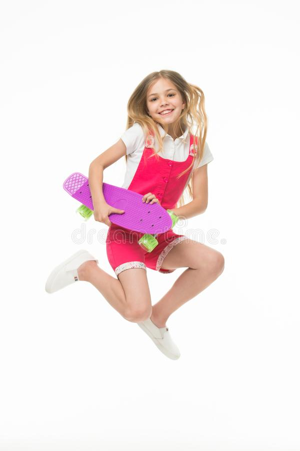 Happy child jump with penny board isolated on white. Little kid smile with skateboard. Fun in motion. Sense of freedom royalty free stock images