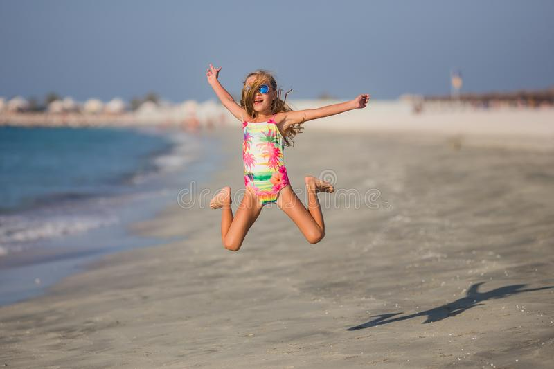 Happy child jumping in summer vacation on exotic tropical beach. royalty free stock photos