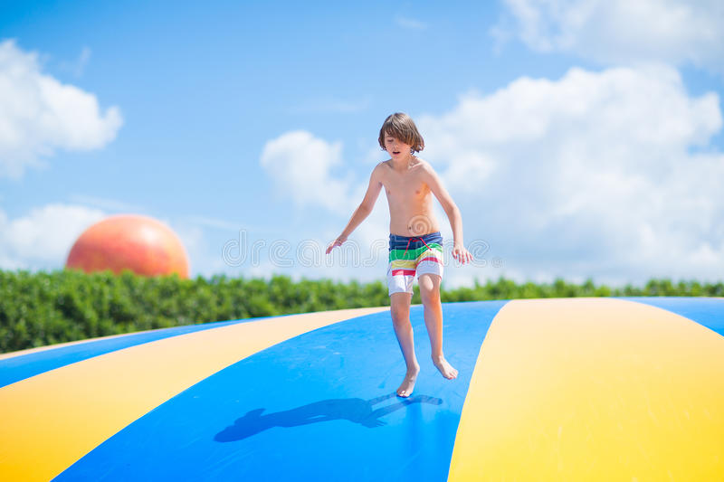 Download Happy Child Jumping On A Trampoline Stock Image - Image: 41979483