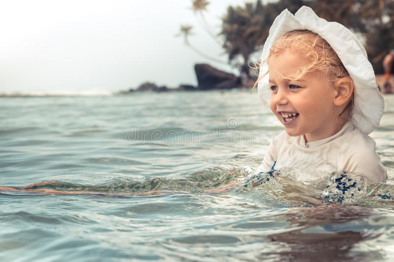 Happy child kid enjoy swimming sea during summer beach holidays vacation lifestyle. stock images