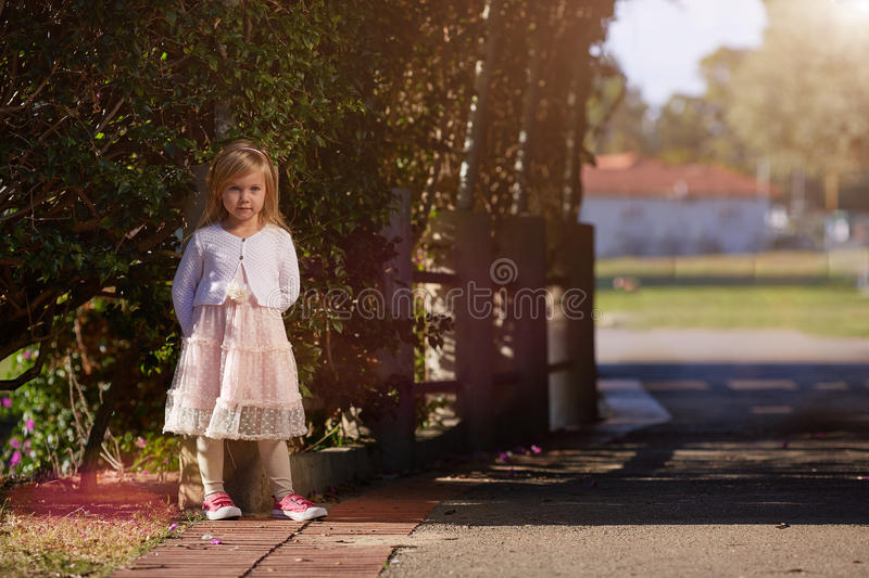 Happy child little girl in a white dress royalty free stock photos