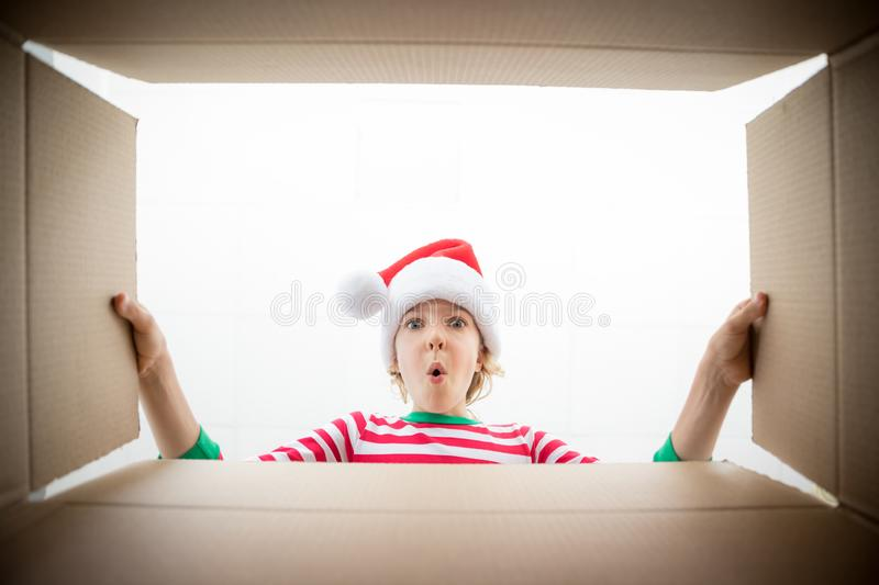 Surprised child unpack Christmas gift box royalty free stock images