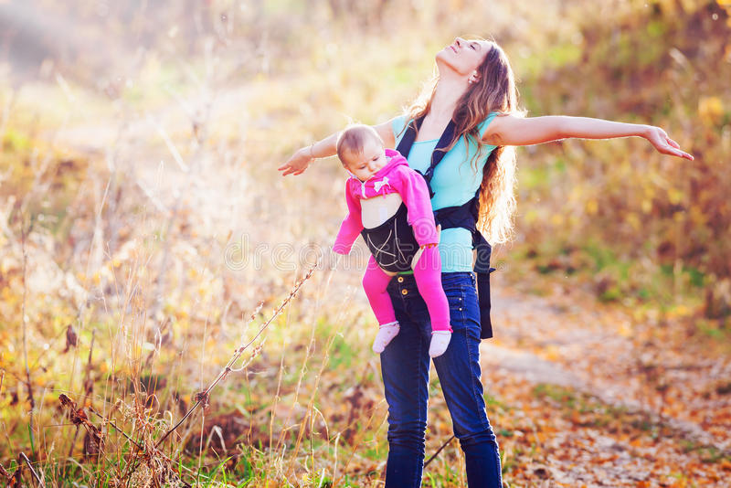 Happy child and mother outdoor at park royalty free stock image