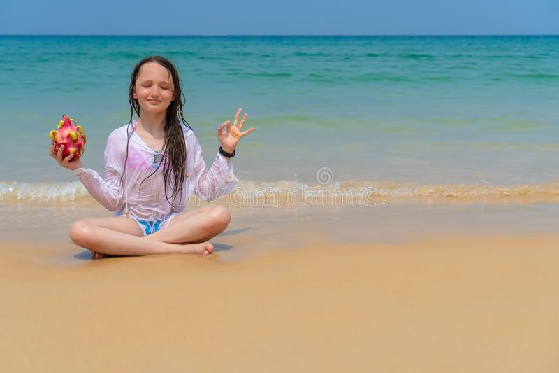 Happy child on the ocean with copy space stock photos