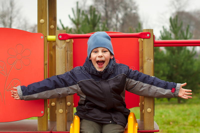 Download Happy Child Open Arms Screaming Of Joy Playground Stock Image - Image: 22127523