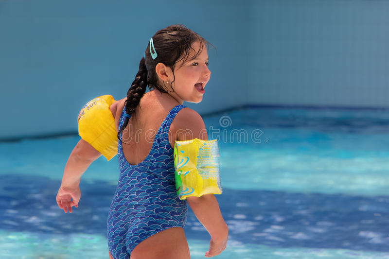 Happy child play swimming pool royalty free stock photo