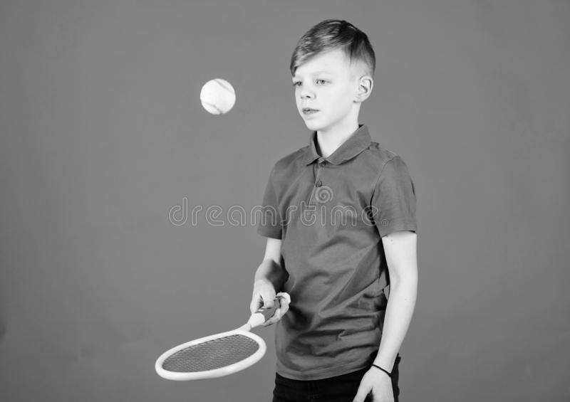 Happy child play tennis with skills. Gym workout of teen boy. Tennis player with racket and ball. Little boy has skills. Fitness diet brings health and energy royalty free stock photos