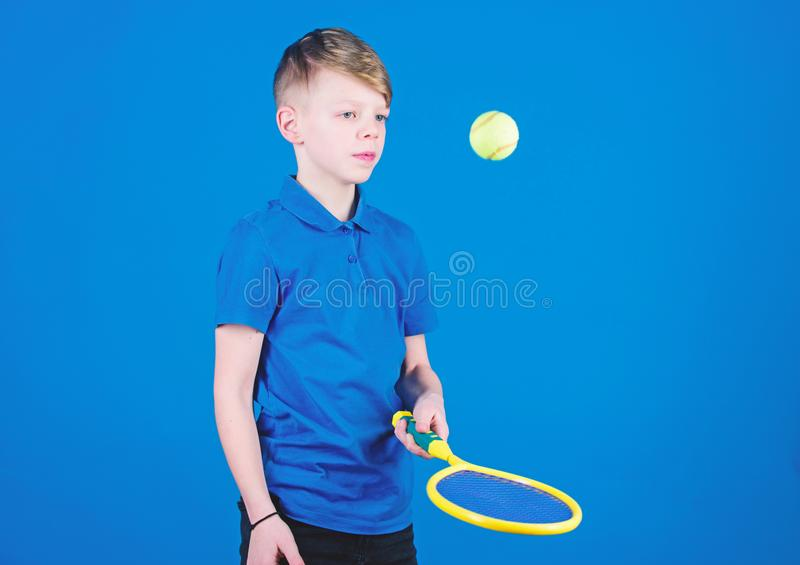 Happy child play tennis with skills. Gym workout of teen boy. Tennis player with racket and ball. Little boy has skills. Fitness diet brings health and energy royalty free stock images