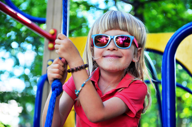 Happy child in playground. Happy child in the playground royalty free stock images
