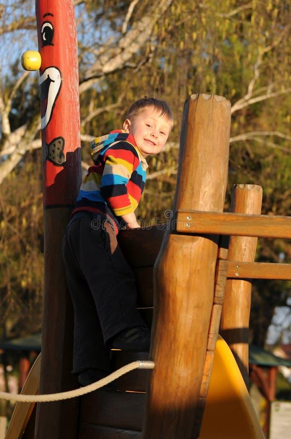 Happy child on playground stock photos