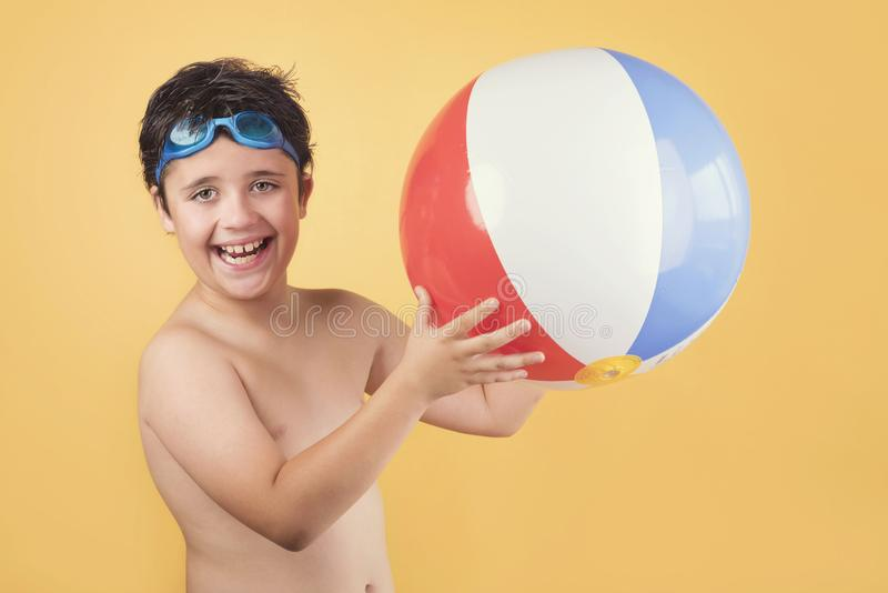 Happy child playing with Beach ball royalty free stock photos
