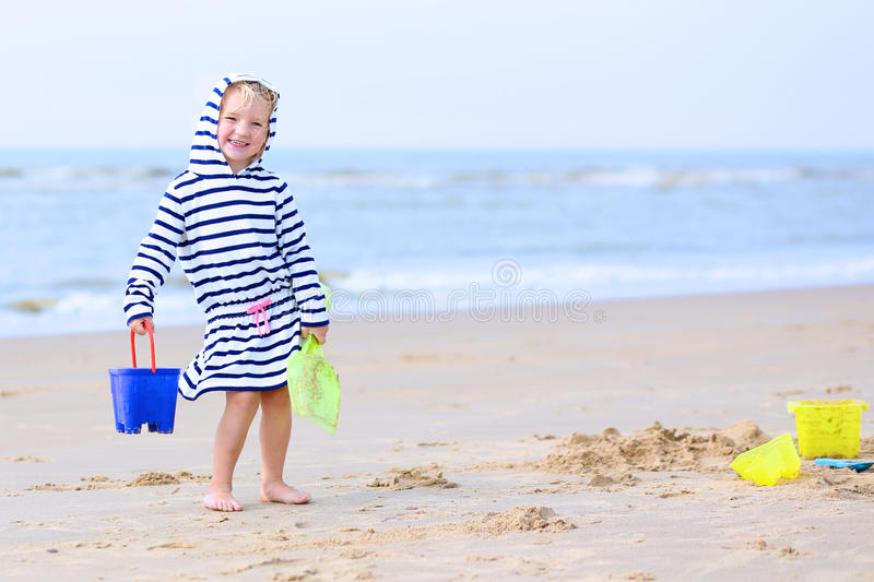 Happy child playing on the beach stock photography