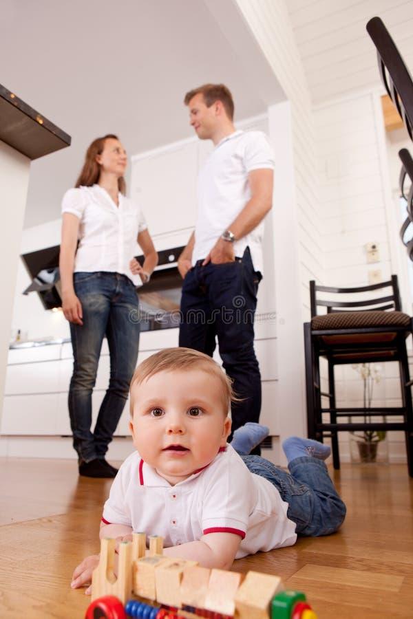 Happy Child Playing on Floor stock photos