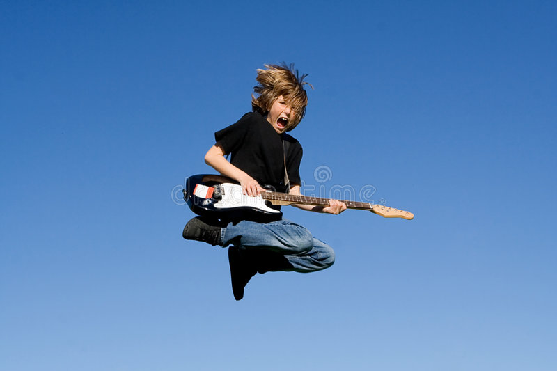 Happy child playing guitar royalty free stock image