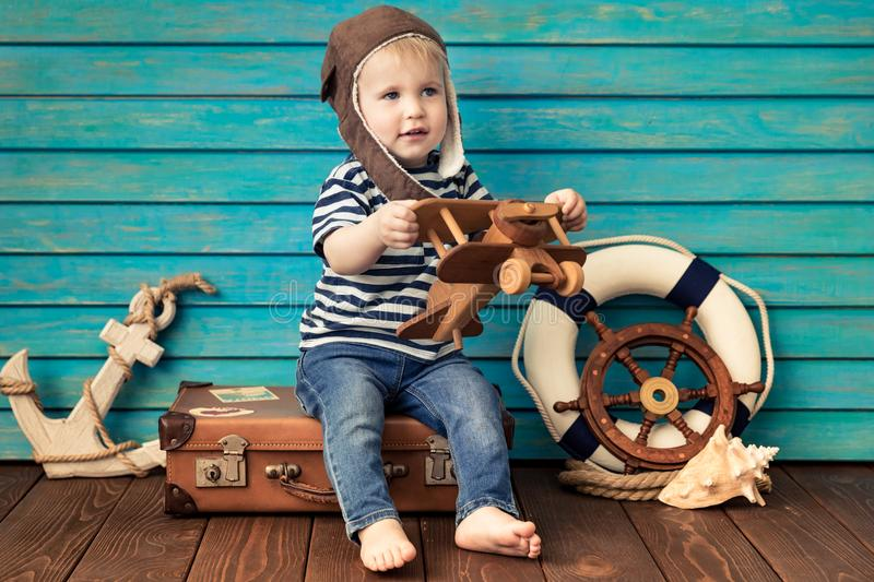 Happy child playing with toy airplane. Happy child playing at home. Baby boy with toy airplane. Summer vacation and travel, dream and imagination concept royalty free stock photography