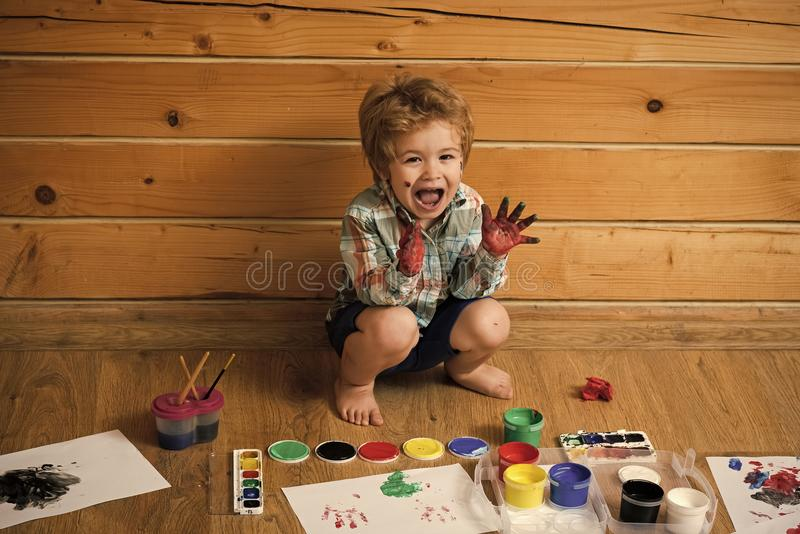 Happy child playing with paints. Kid happy learning and playing royalty free stock photography