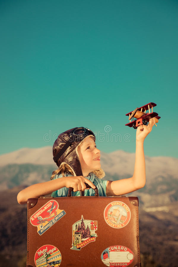 Happy child playing with toy airplane. Against sea and sky background. Kid pilot having fun outdoor. Summer vacation and travel concept. Freedom and imagination royalty free stock photo