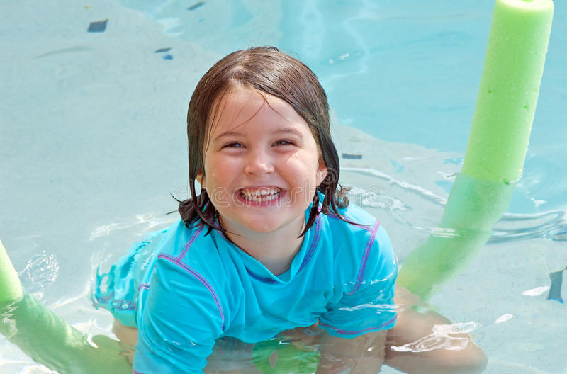 Happy child in pool stock images