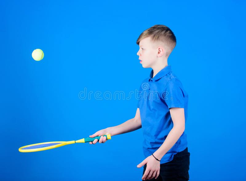 Happy child practice tennis. Little boy practice. Fitness diet brings health and energy. Gym practice of teen boy stock photography