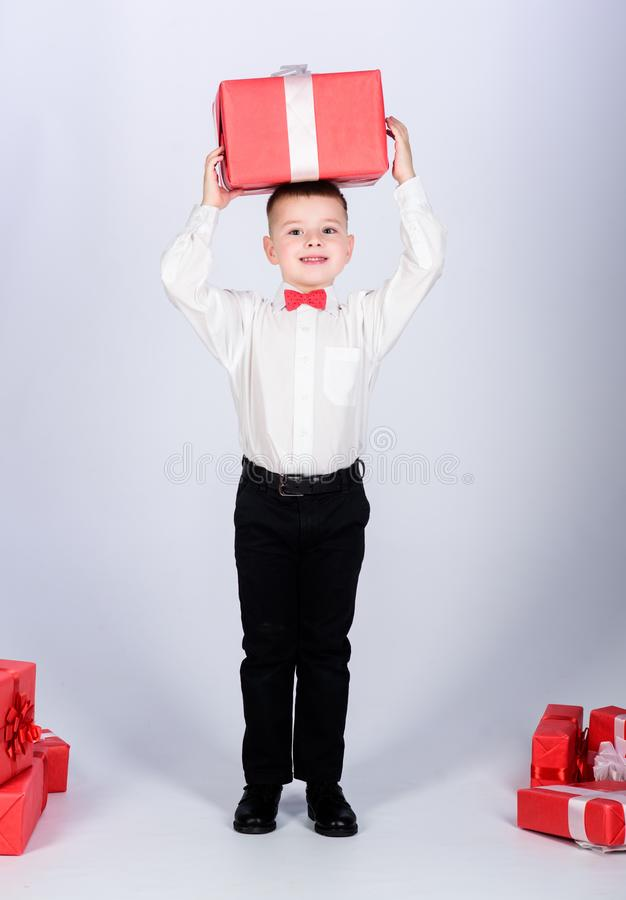 Happy child with present box. Christmas. tuxedo style. Happy childhood. little boy with valentines day gift. Birthday. Party. Shopping. Boxing day. New year stock photos