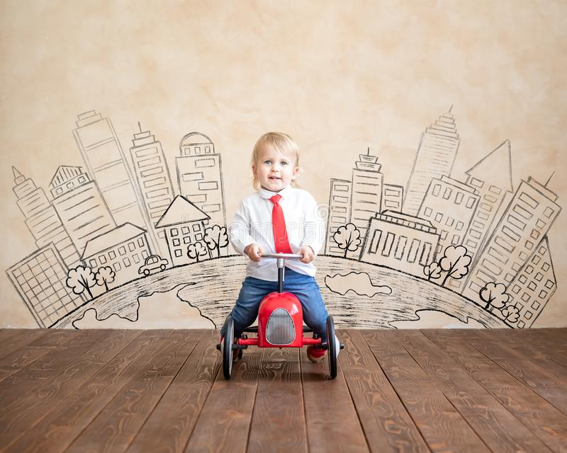 Education, start up and business idea concept. Happy child pretend to be businessmen. Funny kid playing at home. Education, start up and business idea concept stock images