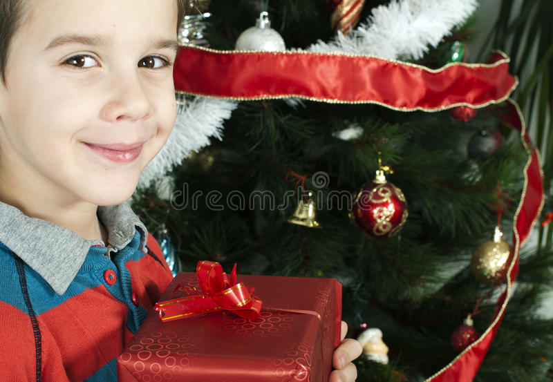 Download Happy Child Receive The Gift Of Christmas Stock Photo - Image of festive, excitement: 28144122