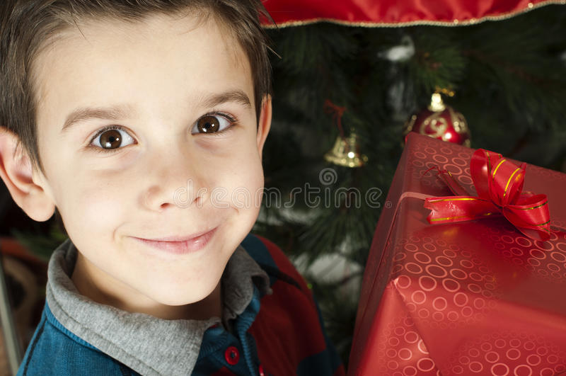 Download Happy Child Receive The Gift Of Christmas Stock Photo - Image: 28144124