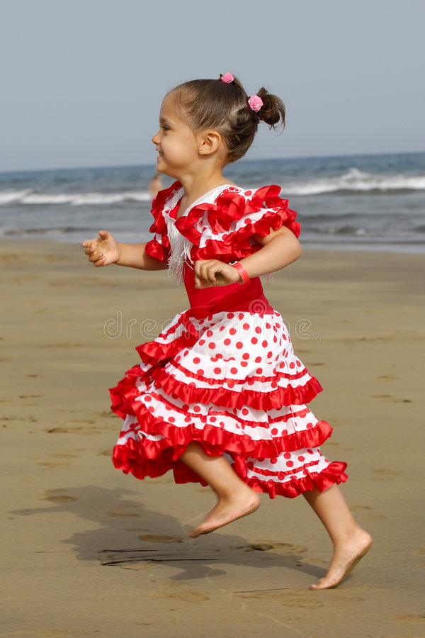 Happy child running. A happy child is running at the beach. Note a bit in motion blur which givs a good speed efect stock photos
