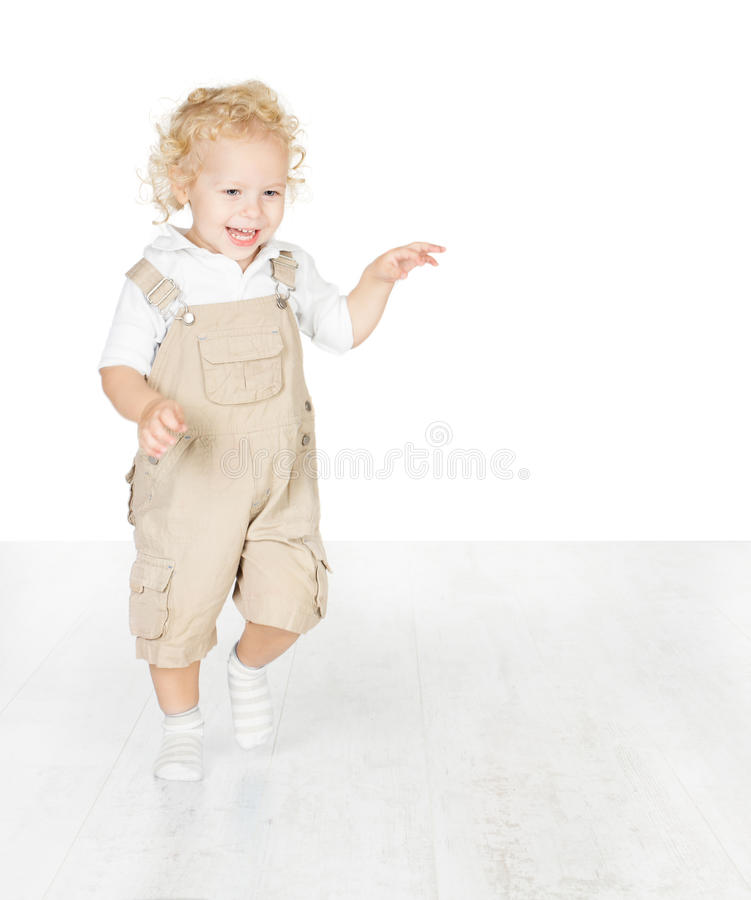 Happy Child, Running On White Floor Stock Photo