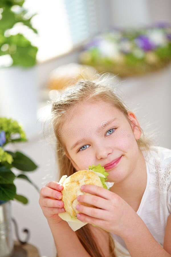 Happy child with a sandwich stock photos