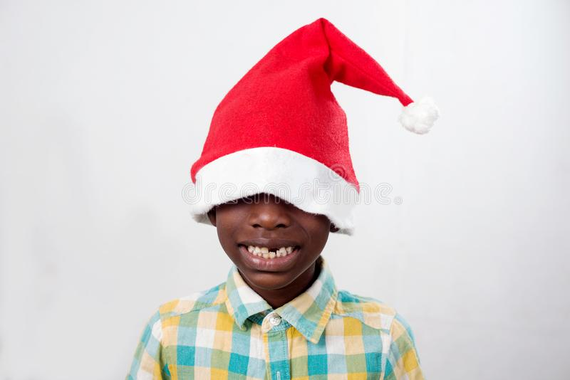 Happy child with a Santa Claus hat stock photos