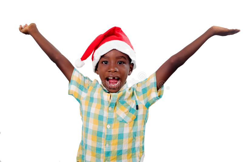 Happy child with a Santa Claus hat royalty free stock photos