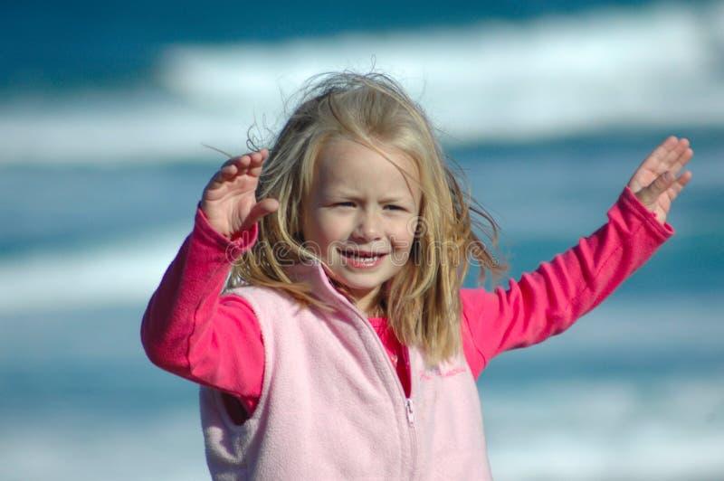 Happy child by sea stock photo