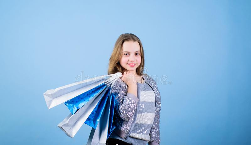 Happy child in shop with bags. Shopping day happiness. Birthday girl shopping. Fashion boutique. Fashion trend. Fashion. Shop. Little girl with bunch packages stock images